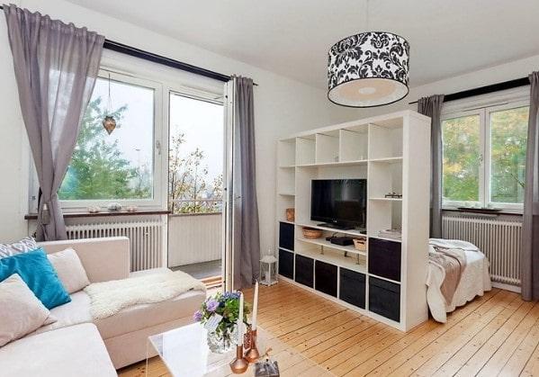 Зонирование жилой комнаты функциональной стенкой или стеллажом
