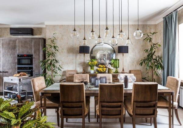Стильный ремонт столовой, объединённой с кухней