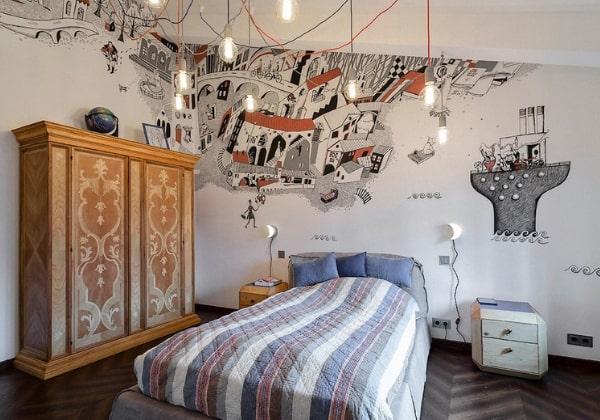 Ремонт детской для мальчика 12 лет, сказочно-морские мотивы и стилизованные рисунки на стене, оригинальное верхнее освещение