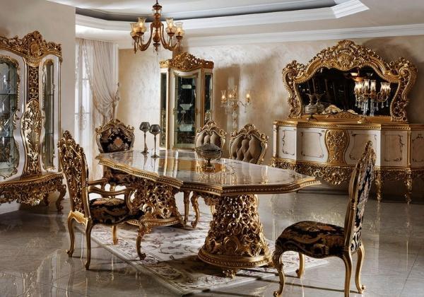Столовая в стиле Барокко, характерные для стиля витиеватости и резная мебель, массивные ножки стола, природные мотивы в декоре