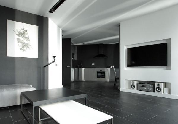Серый мужской минимализм в мужской квартире, акценты расставляются незаметно, преимущественно минималистичными картинами и техникой