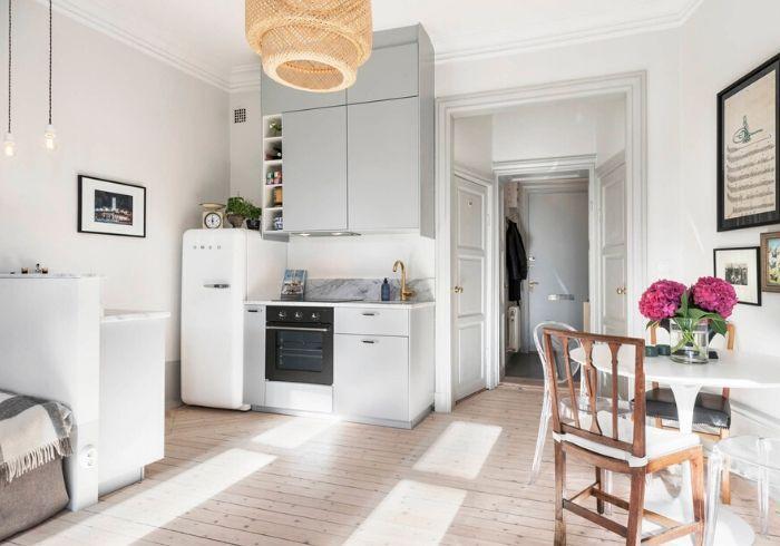 Светлый ремонт в квартире-студии с высокими потолками