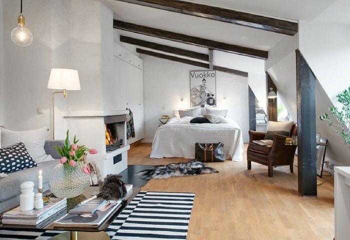 Светлая гостиная-спальня в современном стиле с элементами из дерева