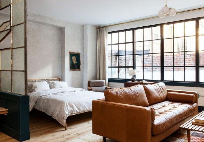 Разграничение спальной и гостиной зон при помощи мебели